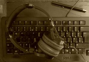 keyboard, headphones and pen